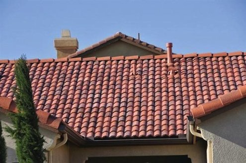 Selecting the right type of roof for your home builder for Metal roof that looks like spanish tile